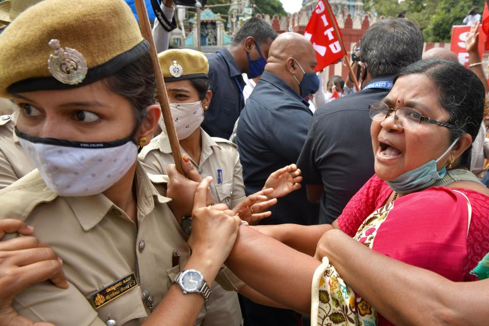 Police personnel detain an activist from a farmers rights organisation during a protest following the recent passing of agriculture bills in the Lok Sabha (lower house), in Bangalore on September 25, 2020. (Photo by Manjunath Kiran / AFP) (Photo by MANJUNATH KIRAN/AFP via Getty Images)