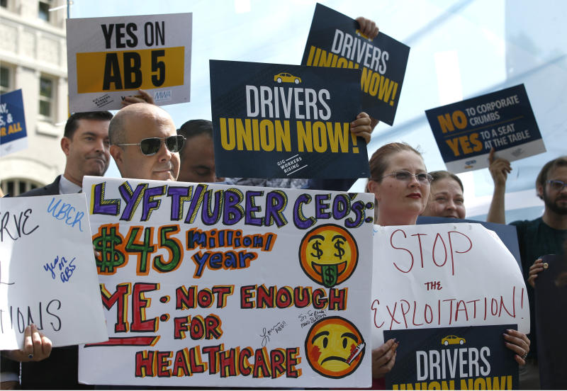 Dozens of supporters of a measure to limit when companies can label workers as independent contractors rally at the Capitol in Sacramento, Calif., Wednesday, Aug. 28, 2019. If approved by the legislature and signed by Gov. Gavin Newsom, AB5, by Assemblywoman Lorena Gonzalez, D-San Diego, would require companies like Uber and Lyft to treat their drivers like employees. (AP Photo/Rich Pedroncelli)