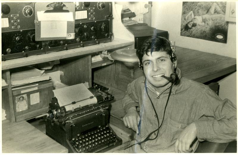 Radioman Peter Orlando sitting behind a typewriter on the recue-tug USS ATR-2. Orlando witnessed the landings at Omaha Beach from his tugboat. | The National WWII Museum