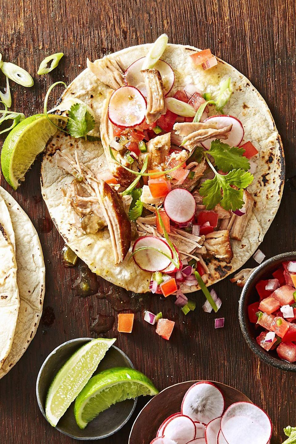 """<p>Pile on the toppings of your choice — radishes, tomatoes, onion, and more — to add <em>even </em>more flavor to these pork tacos. </p><p><em><a href=""""https://www.goodhousekeeping.com/food-recipes/a42403/carnitas-tacos-recipe/"""" rel=""""nofollow noopener"""" target=""""_blank"""" data-ylk=""""slk:Get the recipe for Carnitas Tacos »"""" class=""""link rapid-noclick-resp"""">Get the recipe for Carnitas Tacos »</a></em> </p>"""