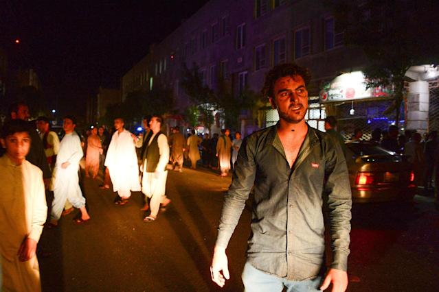 <p>People react on the street, following a suicide bomb attack at a Shiite mosque in Herat on August 1, 2017. (Photo: Hoshang Hashimi/AFP/Getty Images) </p>
