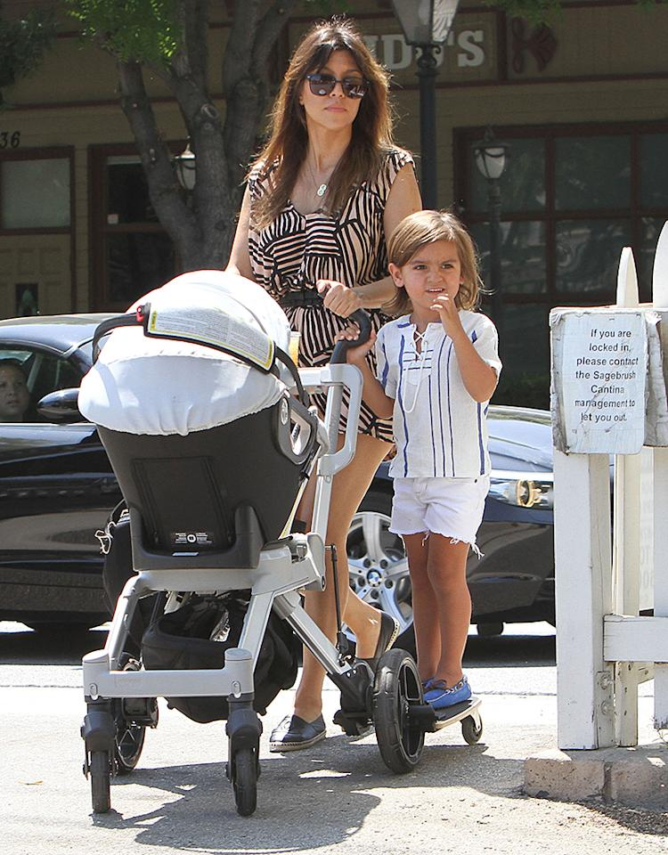 Reality star (and also a new aunt!) Kourtney Kardashian got a little help pushing 11-month-old daughter Penelope's stroller from 3-year-old son Mason as the trio hit up the farmers market in Calabasas, California, over the weekend. (6/29/2013)