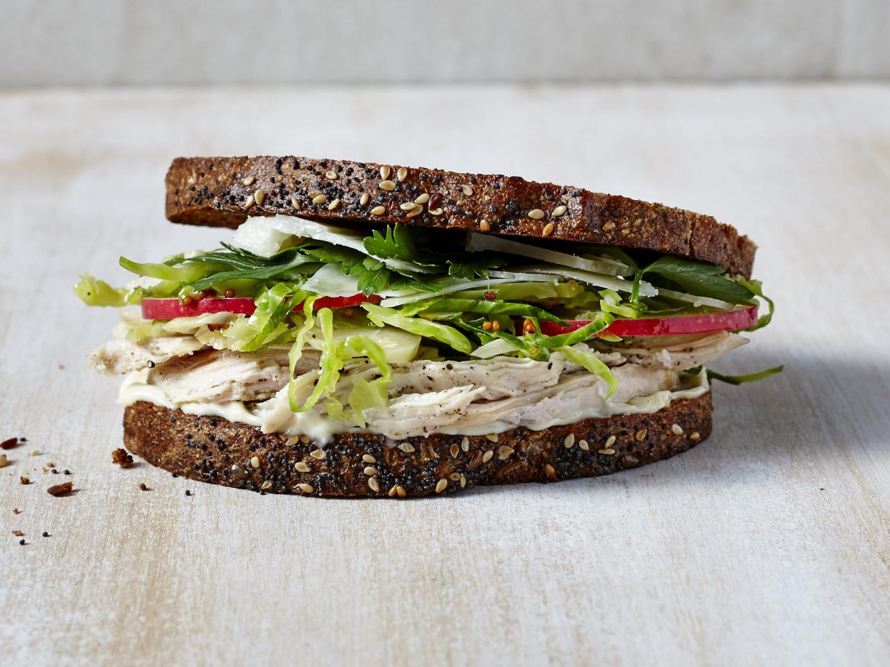 """<p>A quick, zippy slaw of Fuji apple, and fresh parsley transform a typical turkey sandwich—Brussels sprouts and a toasted, nutty whole-grain bread provide the perfect texture and crunch. Not a fan of turkey? Swap in rotisserie chicken instead.</p> <p> <a href=""""https://www.cookinglight.com/recipes/apple-shredded-turkey-brussels-sprouts-salad-sandwiches"""">View Recipe: Apples, Shredded Turkey, and Brussels Sprouts Salad Sandwiches</a></p>"""