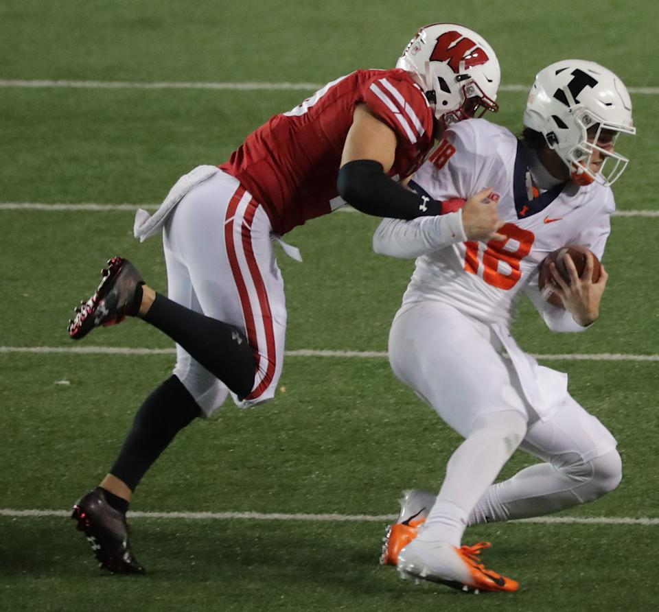 Wisconsin safety Collin Wilder makes an open field tackle after a long run by Illinois quarterback Brandon Peters.