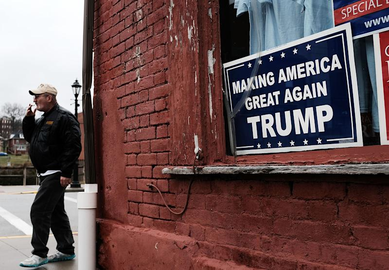 WAYNESBURG, PA - MARCH 01: A Donald Trump sign hangs in the window in the town of Waynesburg near the West Virginia border on March 1, 2018 in Waynesburg, Pennsylvania. Waynesburg, once a thriving coal industry center, has struggled to find its footing in the new energy era. The average household income in the city is $38,255, more than $15,000 a year below the state average and another area coal mine is set to start closing down on March 2nd. Despite President Donald Trump's pledge to bring back the coal industry, some 370 coal miners are expected to lose their jobs at the 4 West Mine in southwestern Pennsylvania when it closes. Following the first wave of layoffs the remaining 175 miners will be let go by June 1 after the company removes underground equipment and seals the mine. (Photo by Spencer Platt/Getty Images)