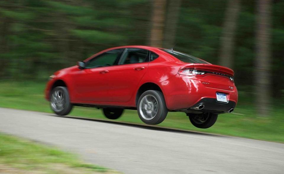 """<p>Jumping this Dodge Dart made perfect sense—it was a <a href=""""http://www.caranddriver.com/comparisons/2013-dodge-dart-rallye-vs-2012-ford-focus-se-comparison-test"""" rel=""""nofollow noopener"""" target=""""_blank"""" data-ylk=""""slk:Rallye trim that we tested"""" class=""""link rapid-noclick-resp"""">Rallye trim that we tested</a> against a Ford Focus, after all! We're thinking that the Dart trim level's extraneous """"e"""" stripped it of any rally-car-like abilities, however, because it did nothing to improve the Dart's flight characteristics or its landing skills. Jumping the compact Dodge did, however, make it seem less boring.</p>"""