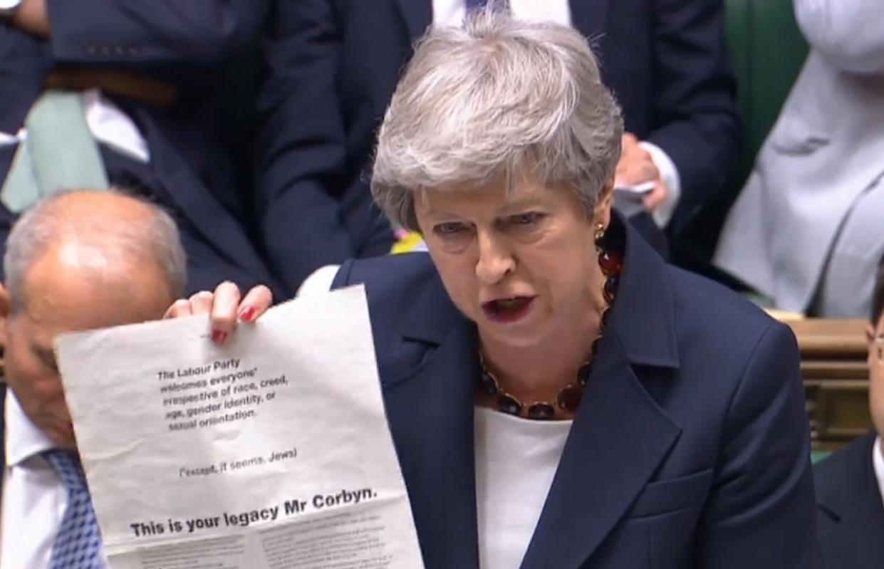 """Prime Minister Theresa May holding up an advert taken from today's Guardian, where more than 60 Labour peers accuse party leader Jeremy Corbyn of """"failing the test of leadership"""", during Prime Minister's Questions in the House of Commons, London. PRESS ASSOCIATION Photo. Picture date: Wednesday July 17, 2019. See PA story POLITICS PMQs. Photo credit should read: House of Commons/PA Wire"""