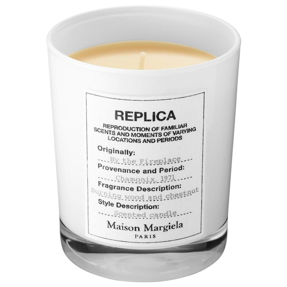 """<h3>Maison Margiela 'REPLICA' By The Fireplace Candle</h3><br>This warm and woodsy scent is supposed to evoke """"the warmth of a cozy fireplace in midwinter"""" — and as one satisfied reviewer put it, """"I can't stop smelling this candle. Reminds me of cozying up, by a fire, next to a really hot guy.""""<br><br><strong>Maison Margiela</strong> 'REPLICA' By The Fireplace Candle, $, available at <a href=""""https://go.skimresources.com/?id=30283X879131&url=https%3A%2F%2Fwww.nordstrom.com%2Fs%2Fmaison-margiela-replica-by-the-fireplace-candle%2F4638661"""" rel=""""nofollow noopener"""" target=""""_blank"""" data-ylk=""""slk:Nordstrom"""" class=""""link rapid-noclick-resp"""">Nordstrom</a>"""