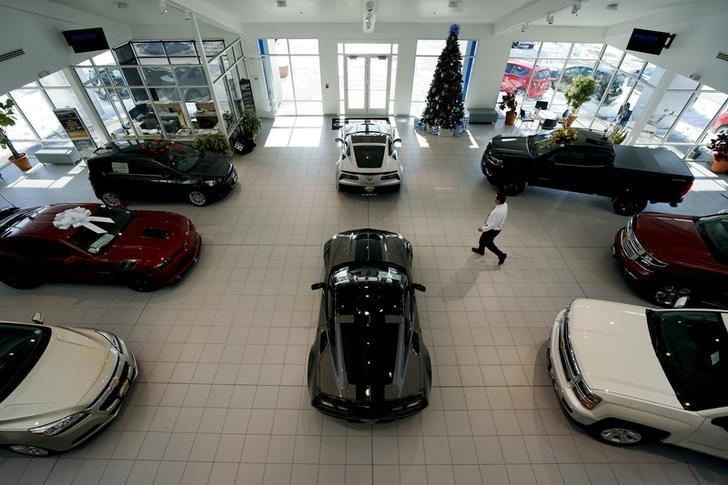 New cars are seen on the showroom floor at the Medved dealer in Denver