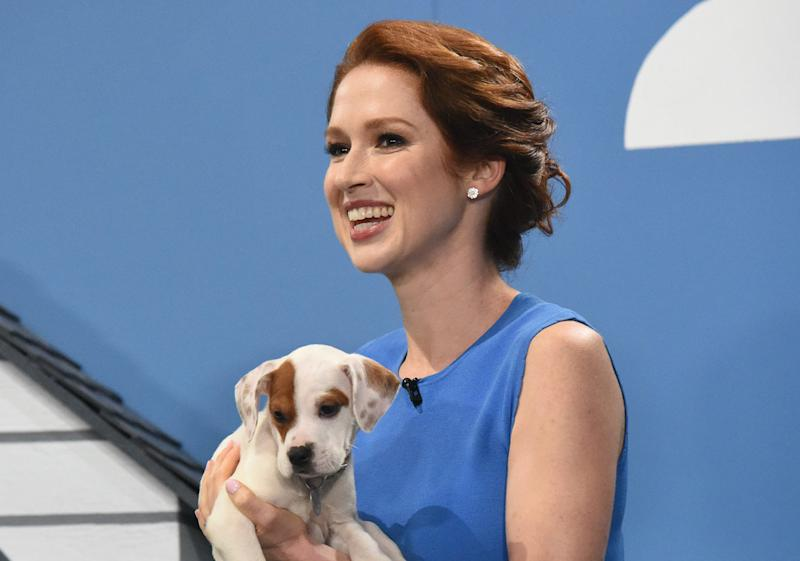 """St. Louis native Ellie Kemper holds a puppyon """"The Late Show with Stephen Colbert"""" Aug. 16."""