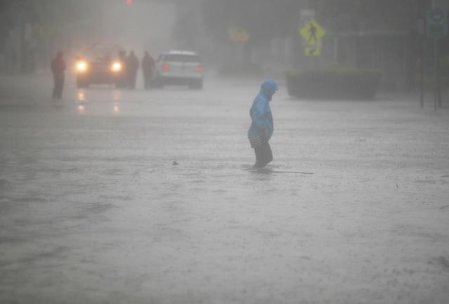 <p><strong>Miami</strong><br>A person walks through a flooded street in the Brickell area of downtown as Hurricane Irma passes through on Sept. 10, 2017 in Miami, Florida. Hurricane Irma made landfall in the Florida Keys as a Category 4 storm on Sunday, lashing the state with 130 mph winds as it moves up the coast. (Photo: Joe Raedle/Getty Images) </p>