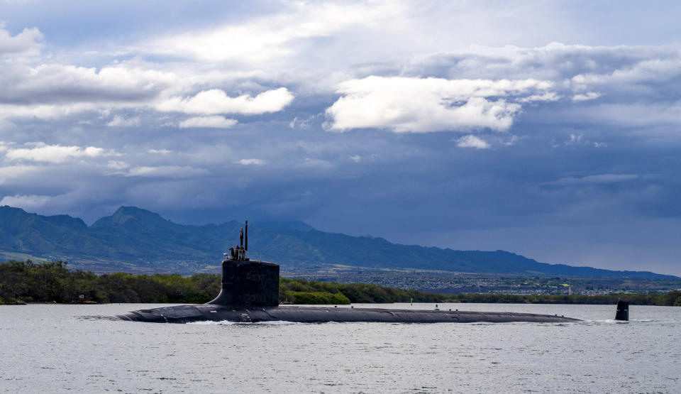 FILE - In this file photo provided by U.S. Navy, the Virginia-class fast-attack submarine USS Missouri (SSN 780) departs Joint Base Pearl Harbor-Hickam for a scheduled deployment in the 7th Fleet area of responsibility, Sept. 1, 2021. Australia decided to invest in U.S. nuclear-powered submarines and dump its contract with France to build diesel-electric submarines because of a changed strategic environment, Prime Minister Scott Morrison said on Thursday, Sept. 16, 2021. (Amanda R. Gray/U.S. Navy via AP, File)