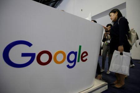 People visit Google's booth at the GMIC in Beijing