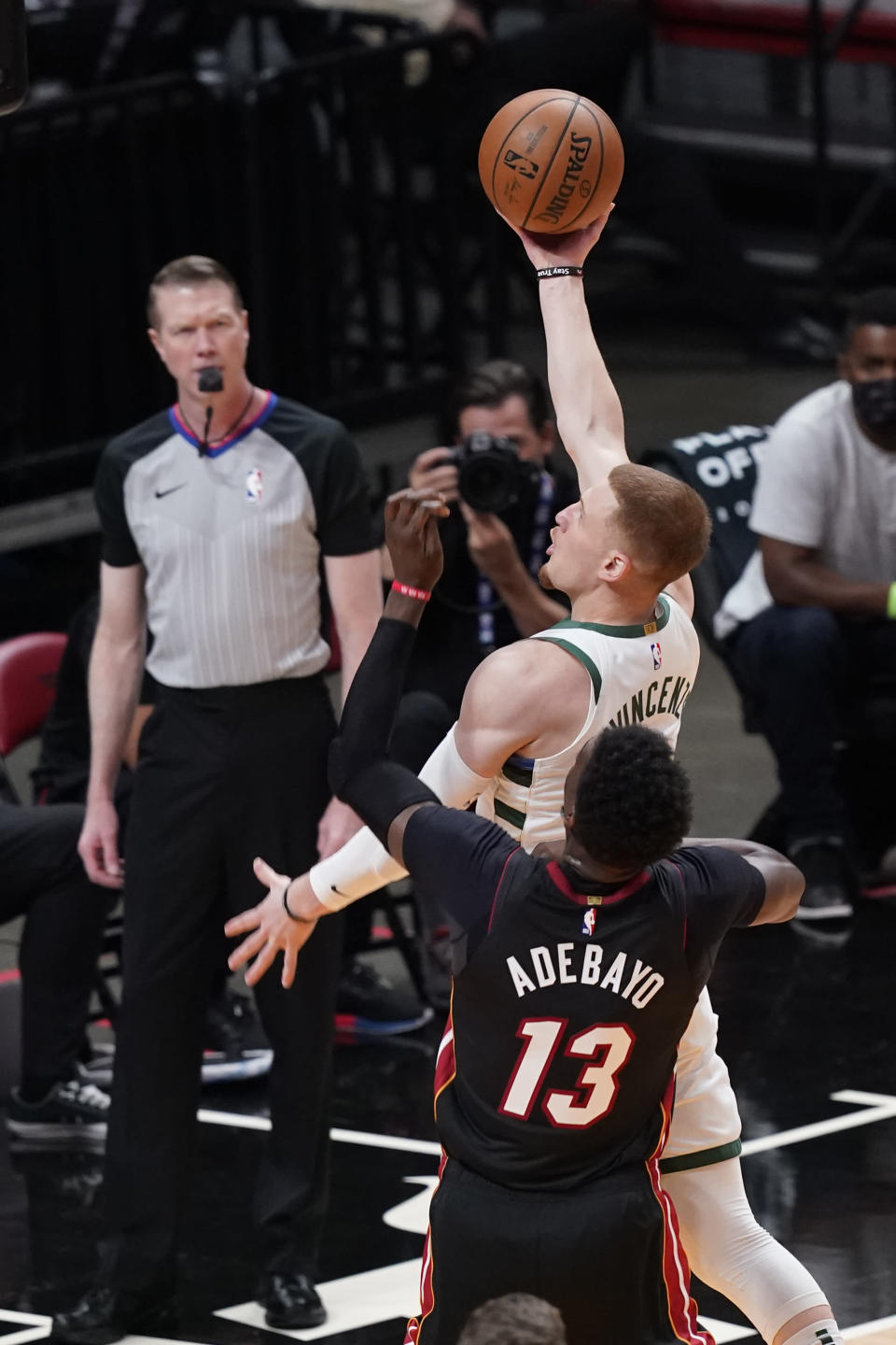 Milwaukee Bucks guard Donte DiVincenzo drives to the basket over Miami Heat center Bam Adebayo (13) during the first half of Game 3 of an NBA basketball first-round playoff series Thursday, May 27, 2021, in Miami. (AP Photo/Marta Lavandier)