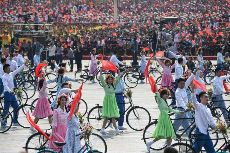Cyclists on parade were a throwback to the days when the bicycle was China's main means of transport (AFP Photo/GREG BAKER)