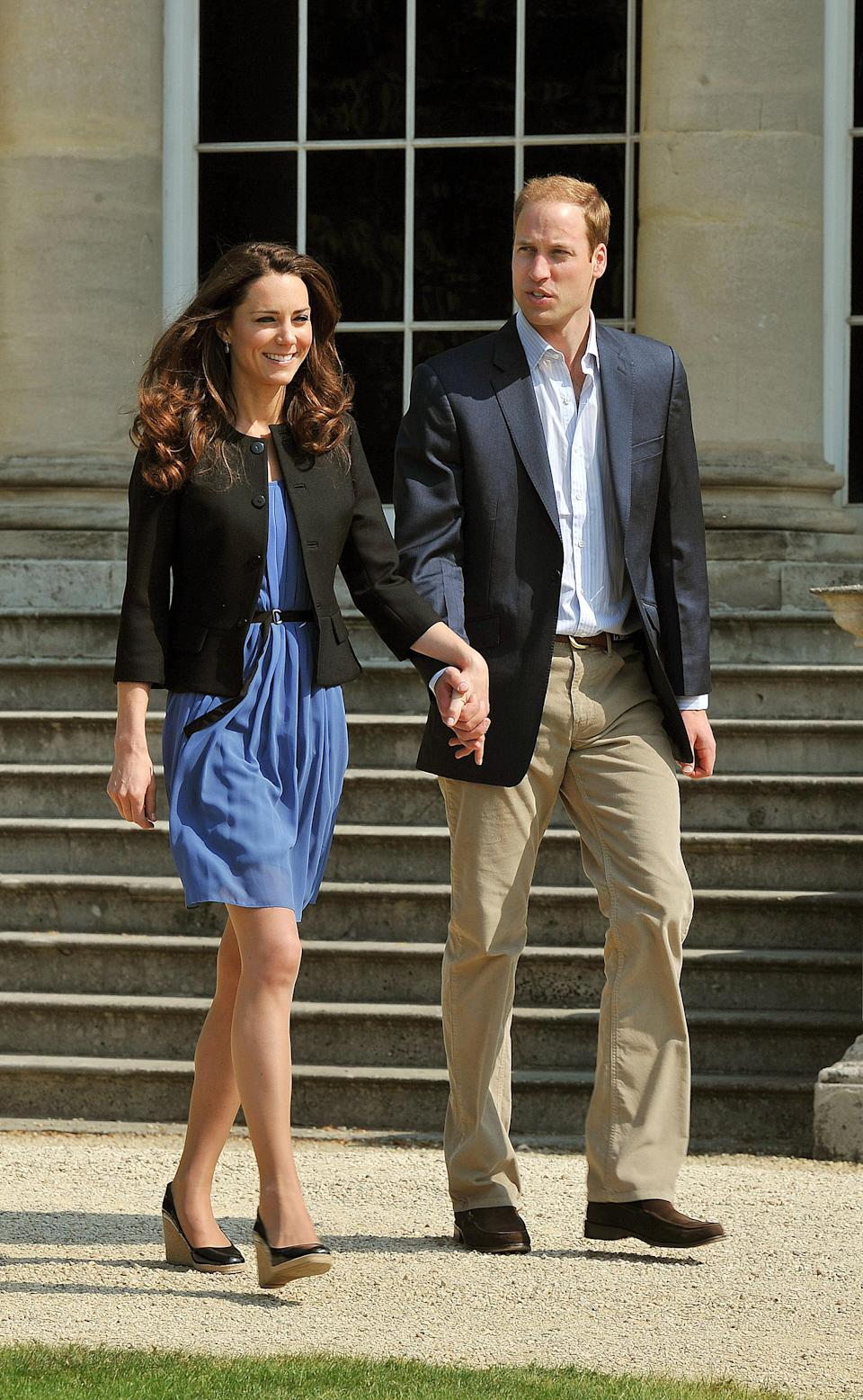 <p>Kate and William leave Buckingham Palace the day after their wedding with the Duchess dressed in a casual blue Zara dress with patent L.K. Bennett wedges and a simple black jacket. <em>[Photo: Getty</em><em>]</em> </p>
