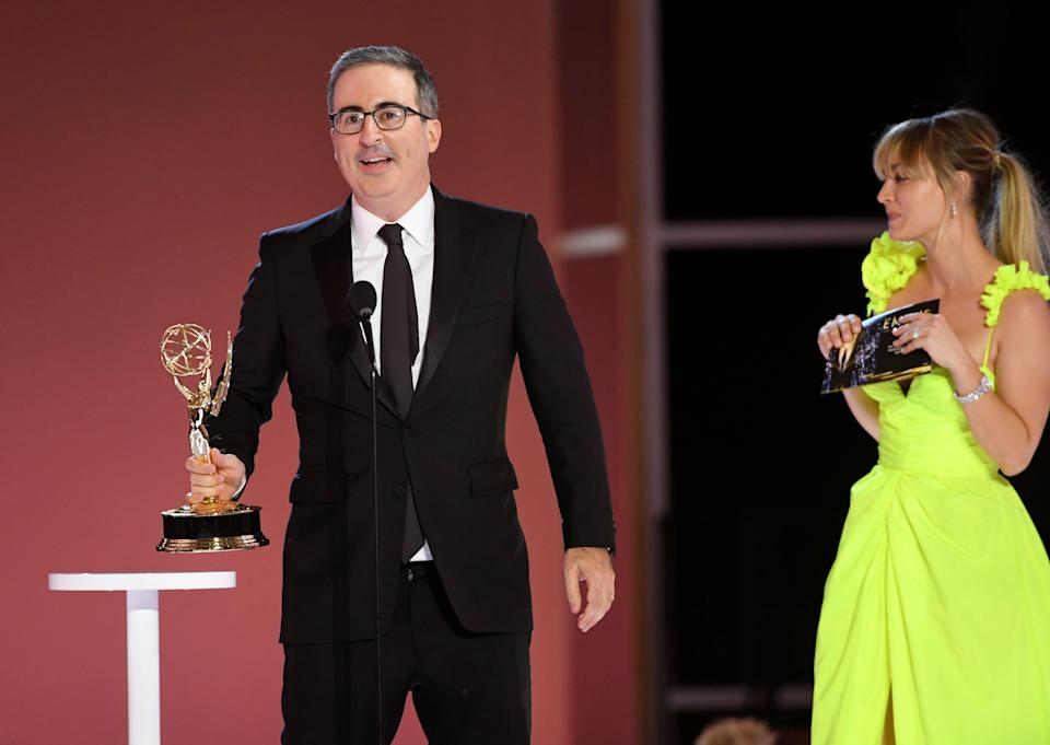 """John Oliver accepts the award for outstanding variety talk series for """"Last Week Tonight with John Oliver."""""""