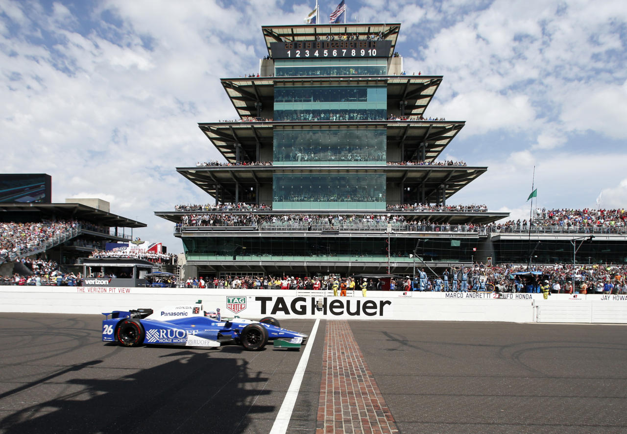 Takuma Sato, of Japan, celebrates as he crosses the Yard of Bricks to win the Indianapolis 500 auto race at Indianapolis Motor Speedway, Sunday, May 28, 2017, in Indianapolis. (AP Photo/Rob Baker)