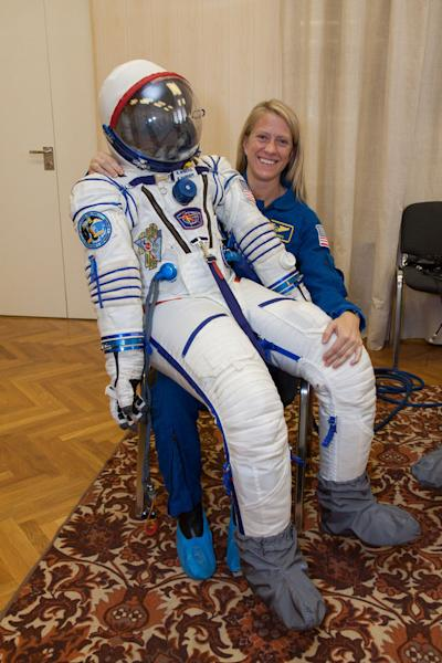 NASA astronaut Karen Nyberg, Expedition 36/37 flight engineer, poses with the Russian Sokol spacesuit she will wear during her trip to the International Space Station. Liftoff set for May 28 (EDT), 2013.