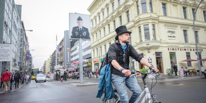 Health Supplements Juha Jaervinen, a participant in Finland's basic income experiment, rides on a rented bike in April 2018..