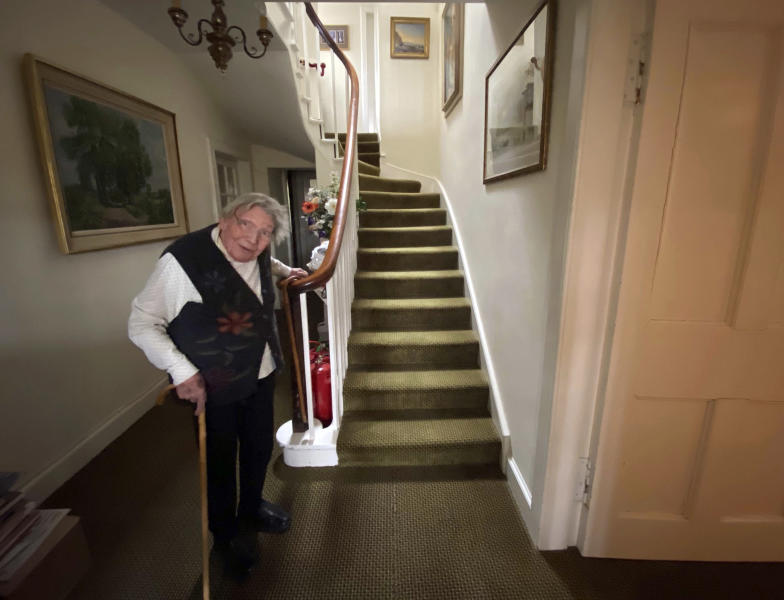 In this undated family handout, Margaret Payne poses for a photo on the stairs of her home in Sutherland, Scotland. Payne, the 90-year-old grandmother who launched an epic climb to raise money for charity completed her fundraiser Tuesday, June 23, 2020 scaling her home's stairs the equivalent of 731 meters (2,398 feet). That's enough to reach the top of the iconic Scottish peak, Suilven. The feat took her 73 days and kept her busy for 10 weeks while the nation sheltered in lockdown due to the COVID-19 pandemic. (Payne Family via AP)
