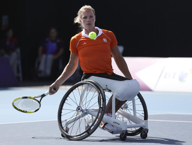 Netherlands' Esther Vergeer returns to Netherlands' Jiske Griffioen, not seen, during the women's single wheelchair tennis semi-final match at the 2012 Paralympics, Wednesday, Sept. 5, 2012, in London. Vergeer won the match. The 31-year-old Dutchwoman has been No. 1 in the wheelchair tennis rankings for more than 13 years. The numbers Vergeer has put up since 1996, when she made her first international appearance, are staggering. She has won 42 grand slam titles (21 singles, 21 doubles) and five Paralympic golds (three singles, two doubles). From 2004-06, she won 250 straight sets. In total, she has won 162 singles titles. (AP Photo/Raissa Ioussouf)
