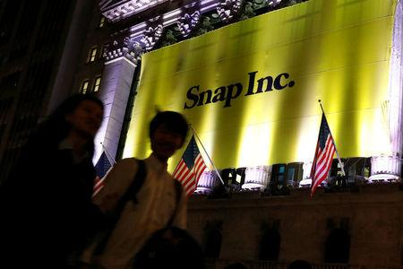 A Banner for Snap Inc. hangs on the facade of the the New York Stock Exchange (NYSE) on the eve of the company's IPO in New York, U.S., March 1, 2017. REUTERS/Brendan McDermid