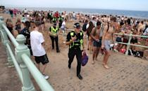 Police at Portobello Beach in Edinburgh after confiscating alcohol from beachgoers.