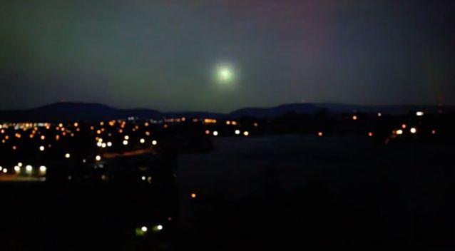 The original video shows a green ball of light exploding over Canberra. Photo: Screenshot