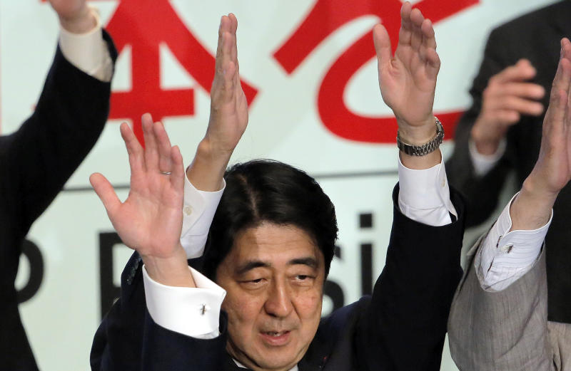 Former Prime Minister Shinzo Abe celebrates after winning his party leader election of Japan's opposition Liberal Democratic Party in Tokyo, Wednesday, Sept. 26, 2012. Abe, known as a hawk and nationalist, won the election Wednesday to become president of the main opposition Liberal Democratic Party. (AP Photo/Itsuo Inouye)