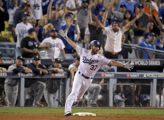The Dodgers' Charlie Culberson celebrates after hitting a home run against the Astros in the 11th inning. (AP)