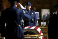 Members of the Louisiana State Police salute as former Louisiana Governor Edwin W. Edwards lies in state in Memorial Hall of the Louisiana State Capitol in Baton Rouge, La., Saturday, July 17, 2021. The colorful and controversial four-term governor died of a respiratory illness on Monday, July 12. (AP Photo/Michael DeMocker)
