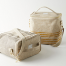 """This structured linen lunch bag comes in three chic design variations and has a removable insulation that will keep your food's temperature regulated for hours. Use the handy mesh pocket on the back for extra storage and the easily adjustable shoulder strap for on-the-go carry. And, because it's machine washable, it truly is a perfect adult lunch box. $44, Anthropologie. <a href=""""https://www.anthropologie.com/shop/lunch-poche-bag2"""" rel=""""nofollow noopener"""" target=""""_blank"""" data-ylk=""""slk:Get it now!"""" class=""""link rapid-noclick-resp"""">Get it now!</a>"""