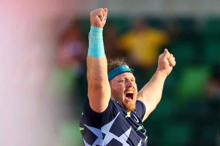 Ryan Crouser celebrates after breaking the 31-year-old world shot put record at the US Olympic track and field trials on Friday