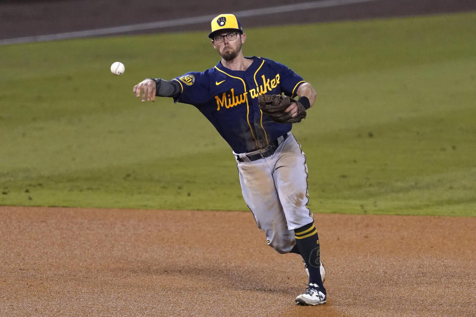 FILE - In this Sept. 30, 2020, file photo, Milwaukee Brewers third baseman Eric Sogard throws to first base during Game 1 of a National League wild-card baseball series in Los Angeles. The Brewers have declined 2021 options on infielders Jedd Gyorko and Eric Sogard as well as outfielder Ben Gamel. (AP Photo/Ashley Landis, File)