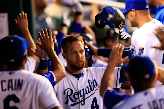 KANSAS CITY, MO - JULY 02: Alex Gordon #4 of the Kansas City Royals is congratualted by teammates in the dugout after hitting a grand slam during the 5th inning of the game against the Cleveland Indians at Kauffman Stadium on July 2, 2013 in Kansas City, Missouri. (Photo by Jamie Squire/Getty Images)