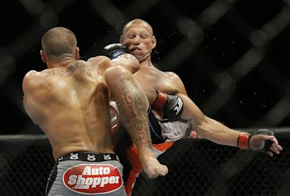 Eddie Alvarez hits Donald Cerrone during their lightweight fight. (AP)