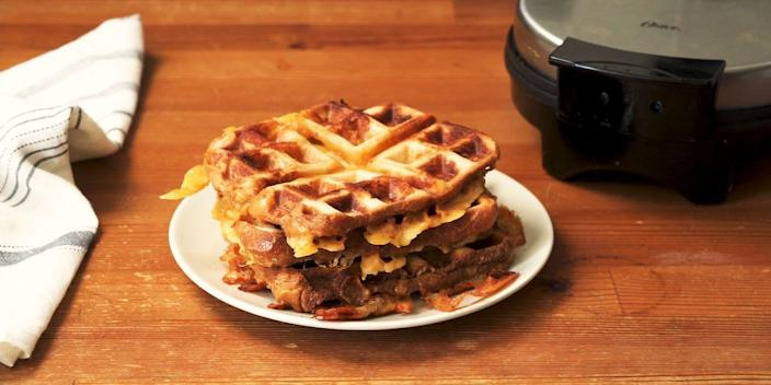 """<p>Waffle. Iron. Grilled. Cheese. Simple, genius, and entirely satisfying.</p><p><em><strong>Get the recipe at <a href=""""https://www.delish.com/cooking/recipe-ideas/a32238506/waffle-iron-grilled-cheese-recipe/"""" rel=""""nofollow noopener"""" target=""""_blank"""" data-ylk=""""slk:Delish"""" class=""""link rapid-noclick-resp"""">Delish</a>.</strong></em></p>"""