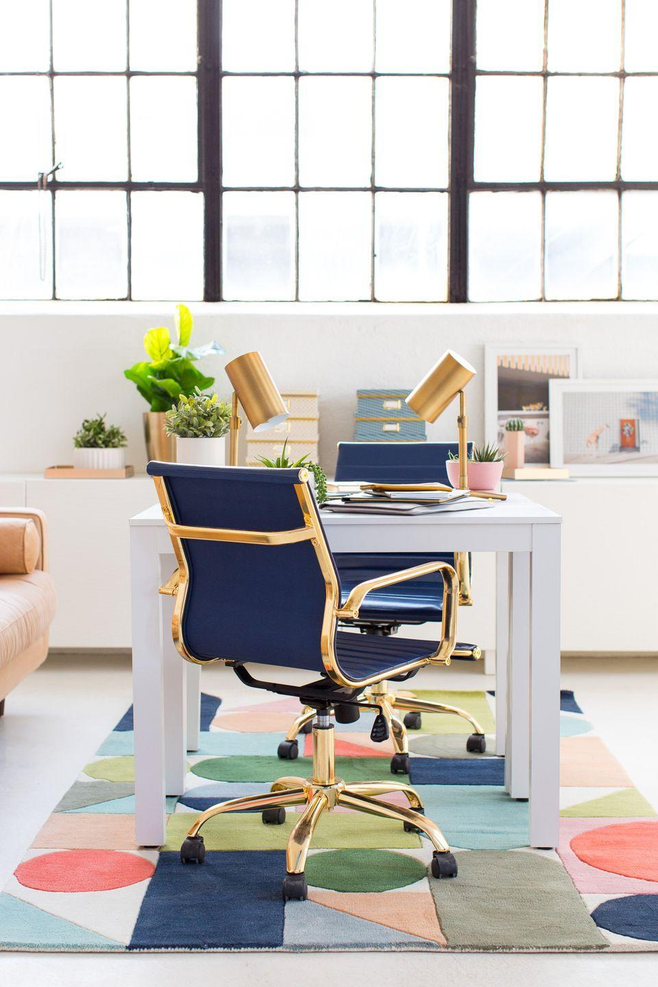"""<p>Your formula for a modern office: white lacquer desk, a geometric rug, and sleek lighting. To make it a little more glam and feminine, add bold color and brass accents. </p><p>See more at <a href=""""https://sugarandcloth.com/modern-interiors-bright-office-space-inspiration/"""" rel=""""nofollow noopener"""" target=""""_blank"""" data-ylk=""""slk:Sugar & Cloth."""" class=""""link rapid-noclick-resp"""">Sugar & Cloth.</a> </p>"""