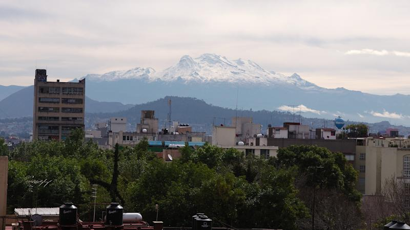 Mexico City, Mexico - 2019: View of the Iztaccíhuatl volcano from the Colonia del Valle district.
