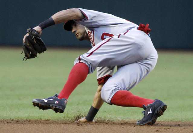 Washington Nationals shortstop Ian Desmond makes a backhand catch of a ground ball for an out against the Arizona Diamondbacks during the second inning of a baseball game on Saturday, Sept. 28, 2013, in Phoenix. (AP Photo/Ralph Freso)