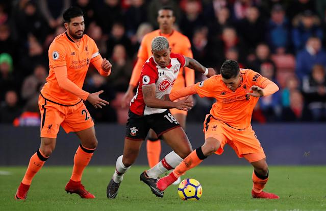 "Soccer Football - Premier League - Southampton vs Liverpool - St Mary's Stadium, Southampton, Britain - February 11, 2018 Southampton's Mario Lemina in action with Liverpool's Roberto Firmino and Emre Can (L) REUTERS/Eddie Keogh EDITORIAL USE ONLY. No use with unauthorized audio, video, data, fixture lists, club/league logos or ""live"" services. Online in-match use limited to 75 images, no video emulation. No use in betting, games or single club/league/player publications. Please contact your account representative for further details."
