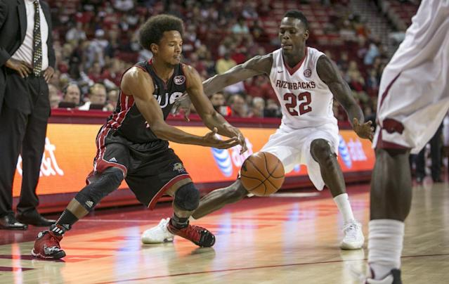 SIU-Edwardsville forward Tim Johnson, left, drops a pass against Arkansas' Jacorey Williams, right, during the first half of an NCAA college basketball game in Fayetteville, Ark., Friday, Nov. 8, 2013. (AP Photo/Gareth Patterson)