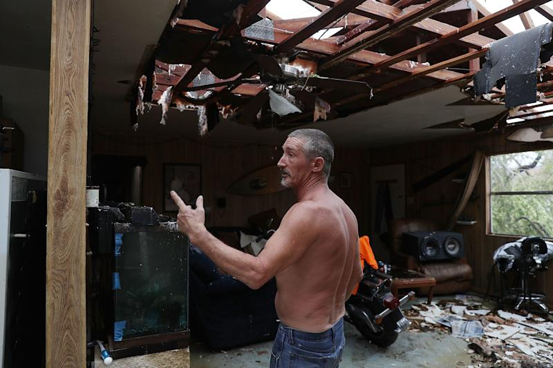 Aaron Tobias who said he lost everything stands in what is left of his home in Rockport. Mr. Tobias said he was able to get his wife and kids out before the storm arrived but he stayed there and rode it out.