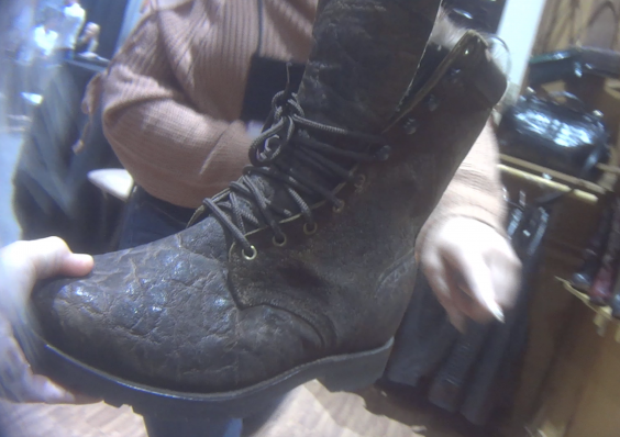 A boot sample made from elephant skin is displayed for custom ordering (HSUS)