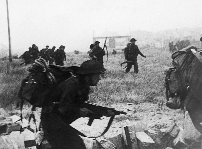 British Commandos advancing inland to gain the first village in Normandy, France, on June 7, 1944. (Photo: AP)
