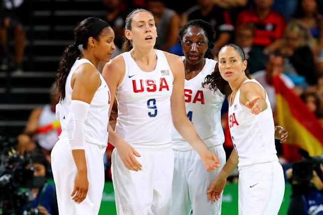 """Breanna Stewart (9), <a class=""""link rapid-noclick-resp"""" href=""""/wnba/players/4613/"""" data-ylk=""""slk:Tina Charles"""">Tina Charles</a> and Sue Bird, far right, all played at UConn. (Photo by Tom Pennington/Getty Images)"""
