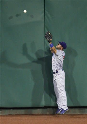 Chicago Cubs center fielder Brett Jackson can't get to a ball hit by Pittsburgh Pirates' Pedro Alvarez during the sixth inning of a baseball game Friday, Sept. 7, 2012, in Pittsburgh. The hit was the first of the game by the Pirates. (AP Photo/Keith Srakocic)
