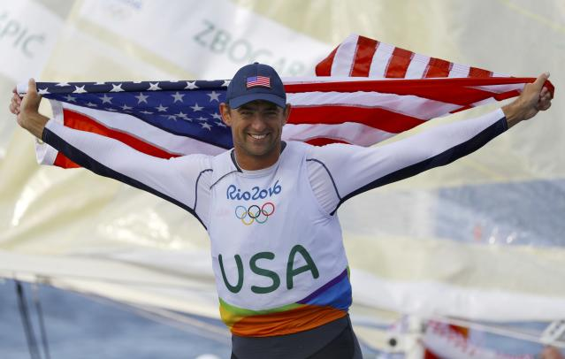 2016 Rio Olympics - Sailing - Final - Men's One Person Dinghy (Heavyweight) - Finn - Medal Race - Marina de Gloria - Rio de Janeiro, Brazil - 16/08/2016. Caleb Paine (USA) of USA celebrates bronze medal. REUTERS/Brian Snyder FOR EDITORIAL USE ONLY. NOT FOR SALE FOR MARKETING OR ADVERTISING CAMPAIGNS.