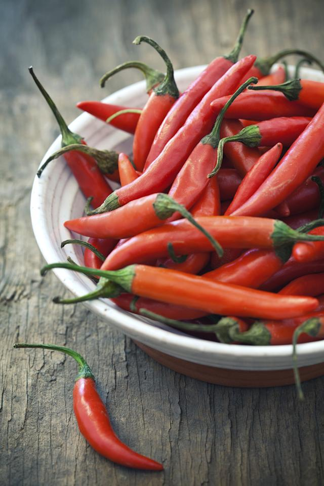 """<p>A half-cup of chopped or diced chili peppers delivers 107.8 mg of vitamin C. Plus, researchers from the University of Buffalo found that capsaicin, the compound that makes chili peppers hot, may help <a href=""""http://news.health.com/2009/02/25/chili-pepper-compound-can-bring-pain-relief/"""">relieve joint and muscle pain</a>.</p> <p><strong>RELATED: <a href=""""https://www.health.com/food/6-sriracha-recipes-for-spicy-food-lovers"""">6 Sriracha Recipes For Spicy Food Lovers</a></strong></p> <p> <b>Try this recipe: <a href=""""https://www.health.com/health/recipe/0,,10000001063305,00.html"""">Red Bean and Poblano Chili</a></b></p>"""